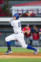 Brandon Dulin (26) of the Burlington Royals follows through on his swing against the Danville Braves at Burlington Athletic Park on July 5, 2014 in Burlington, North Carolina.  The Royals defeated the Braves 5-4.  (Brian Westerholt/Four Seam Images)