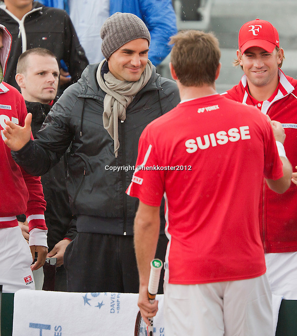 14-09-12, Netherlands, Amsterdam, Tennis, Daviscup Netherlands-Suiss, Roger Federer congratulates  Stanislas Wawrinka with his victory over Haase