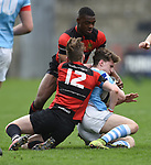 David Mescall and Ikem Ugwueru of Ennis  in action against  Garryowen during their U-18 Munster Club Final at Thomond Park. Photograph by John Kelly.