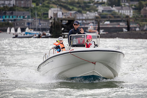 Royal Cork's Alex Barry and children out for a spin in a small motorboat in Cork Harbour