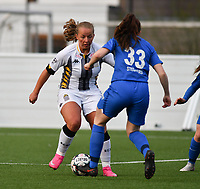 Megane Vos (20) of Sporting Charleroi and Emily Steijvers (33) of KRC Genk in a duel during a female soccer game between Sporting Charleroi and KRC Genk on the 4 th matchday in play off 2 of the 2020 - 2021 season of Belgian Scooore Womens Super League , friday 30 th of April 2021  in Marcinelle , Belgium . PHOTO SPORTPIX.BE | SPP | Jill Delsaux