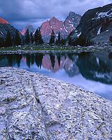 Sunset glow on Teton Peak above Lake Solitude; Grand Teton National Park, WY
