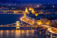 Beautiful aerial view of the lit-up Szechenyi Chain bridge, the Danube, and the Hungarian parliament, from Gellert Hill at twilight, Budapest, Hungary