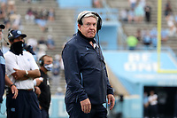 CHAPEL HILL, NC - OCTOBER 10: Head coach Mack Brown of North Carolina watches the play clock count down before calling a timeout during a game between Virginia Tech and North Carolina at Kenan Memorial Stadium on October 10, 2020 in Chapel Hill, North Carolina.