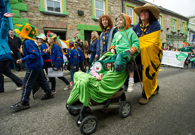Little Annie Mc Keown sleeps this one out as brother Rory and mother Fiona take part in the the St Patrick's Day Parade at Killaloe. Photograph by John Kelly.
