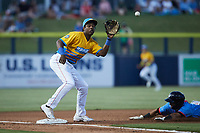DJ Gladney (8) of the Rapidos de Kannapolis waits for a throw at third base during the game against the Guerreros de Fayetteville at Atrium Health Ballpark on June 24, 2021 in Kannapolis, North Carolina. (Brian Westerholt/Four Seam Images)