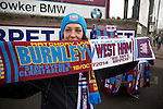 Burnley 1 West Ham United 3, 18/10/2014. Turf Moor, Premier League. A woman selling souvenir scarves on sale outside The fixture was won by the visitors by three goals to one watched by 18,936 spectators. The defeat meant that Burnley still had not won a league match since being promoted from the Championship the previous season. Photo by Colin McPherson.