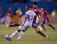SAN PEDRO SULA, HONDURAS - SEPTEMBER 8: Maynor Figueroa #3 of Honduras is defended by Ricardo Pepi #14 of the United States during a game between Honduras and USMNT at Estadio Olímpico Metropolitano on September 8, 2021 in San Pedro Sula, Honduras.