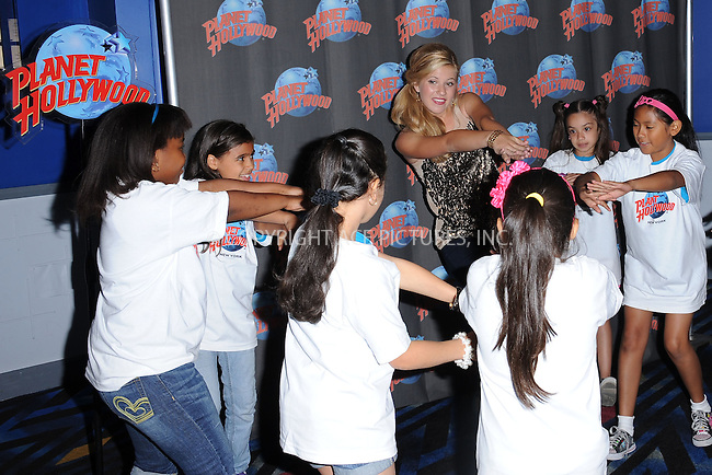 """WWW.ACEPIXS.COM . . . . . .August 12, 2011...New York City...Caroline Sunshine  at Planet Hollywood Times Square  to promote her starring role in the Disney Channel comedy series """"Shake It Up"""" with a special meet & greet with 10 lucky children from WHEDco on August 12, 2011 in New York City.....Please byline: KRISTIN CALLAHAN - ACEPIXS.COM.. . . . . . ..Ace Pictures, Inc: ..tel: (212) 243 8787 or (646) 769 0430..e-mail: info@acepixs.com..web: http://www.acepixs.com ."""