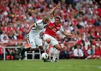 Pictured L-R: Luke Moore of Swansea is pushing Francis Coquelin of Arsenal away. Saturday 10 September 2011<br />