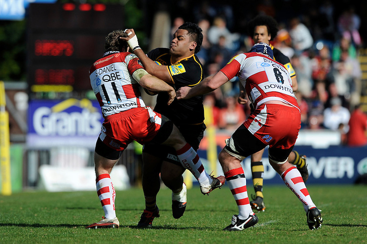 Billy Vunipola of London Wasps runs into James Simpson-Daniel (left) and Peter Buxton of Gloucester Rugby during the Aviva Premiership match between London Wasps and Gloucester Rugby at Adams Park on Sunday 1st April 2012 (Photo by Rob Munro)