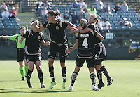 Christine Sinclair (center) celebrates her goal with Tiffany Weimer (8), Rachel Buehler (4) and Tiffeny Milbrett (right). Washington Freedom defeated FC Gold Pride 4-3 at Buck Shaw Stadium in Santa Clara, California on April 26, 2009.
