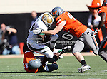 Baylor Bears running back Terrance Ganaway (24) and Oklahoma State Cowboys linebacker Caleb Lavey (45) in action during the game between the Baylor Bears and the Oklahoma State Cowboys at the Boone Pickens Stadium in Stillwater, OK. Oklahoma State defeats Baylor 59 to 24.