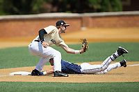 Wake Forest Demon Deacons third baseman Johnny Aiello (2) fields a throw as Frank Maldonado (3) of the Pitt Panthers slides into the base with a triple at David F. Couch Ballpark on May 20, 2017 in Winston-Salem, North Carolina. The Demon Deacons defeated the Panthers 14-4.  (Brian Westerholt/Four Seam Images)