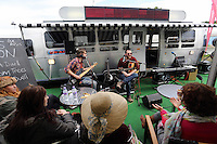 Sunday 25 May 2014, Hay on Wye, UK<br /> Pictured: A guitar duo performing infront of the BBC radio trailer.<br /> Re: The Hay Festival, Hay on Wye, Powys, Wales UK.