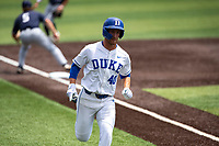 Duke Blue Devils left fielder RJ Schreck (40) hustles to the plate against the Liberty Flames in NCAA Regional play on Robert M. Lindsay Field at Lindsey Nelson Stadium on June 4, 2021, in Knoxville, Tennessee. (Danny Parker/Four Seam Images)