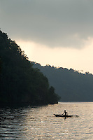 Child canoeing across the Fjord at sunrise, Tufi, Cape Nelson, Oro Province, Papua New Guinea