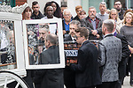 © Joel Goodman - 07973 332324 . 30/06/2017 . Stockport , UK . Martyn's coffin is carried in to the Town Hall . The funeral of Martyn Hett at Stockport Town Hall . Martyn Hett was 29 years old when he was one of 22 people killed on 22 May 2017 in a murderous terrorist bombing committed by Salman Abedi, after an Ariana Grande concert at the Manchester Arena . Photo credit : Joel Goodman