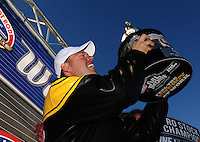Oct. 30, 2011; Las Vegas, NV, USA: NHRA pro stock driver Jason Line celebrates after winning pro stock world championship for 2011 at the Big O Tires Nationals at The Strip at Las Vegas Motor Speedway. Mandatory Credit: Mark J. Rebilas-
