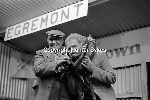 Gurning Competition at the Egremont Crabapple Fair, Egremont, Cumbria England 1975.<br /> <br /> Mr John S.Kirby holding the braffin during the men's gurning competition.