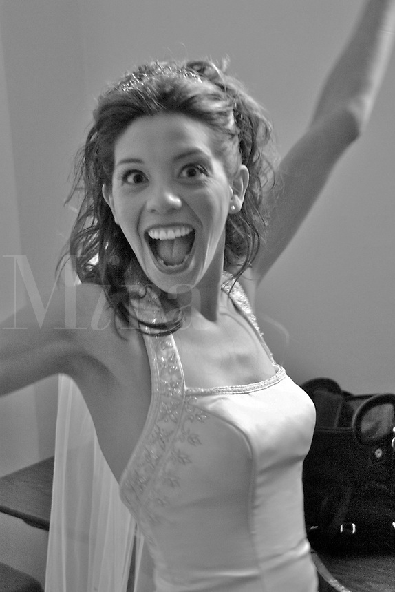 An excited bride just before she is to get married in black and white