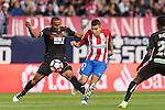 Angel Correa of Atletico de Madrid fights for the ball with Gabriel Silva of Granada CF during their La Liga match between Atletico de Madrid and Granada CF at the Vicente Calderon Stadium on 15 October 2016 in Madrid, Spain. Photo by Diego Gonzalez Souto / Power Sport Images