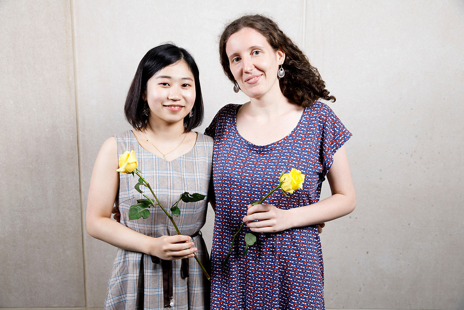 Contestants Naho Higuchi of Japan, left, and Louisic Dulbecco of France pose at a photo booth during the opening reception and dinner of the 11th USA International Harp Competition at Indiana University in Bloomington, Indiana on Wednesday, July 3, 2019. (Photo by James Brosher)