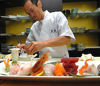 Milano Matsuri Festival 2014 - Il famoso chef giapponese Ikeda Osamu, impegnato nella preparazione di un piatto di sashimi.<br /> Famous Japanese chef Osamu Ikeda, engaged in the preparation of a plate of sashimi. <br /> Photo Livio Senigalliesi