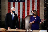 Speaker of the House Nancy Pelosi, D-Calif., and Vice President Mike Pence talk before a joint session of the House and Senate convenes to count the Electoral College votes cast in November's election, at the Capitol in Washington, Wednesday, Jan. 6, 2021. (AP Photo/J. Scott Applewhite)<br /> Credit: J. Scott Applewhite / Pool via CNP/AdMedia