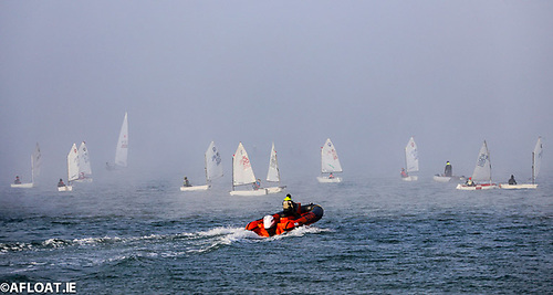 A safety RIB on patrol in Dun Laoghaire Harbour as Optimist dinghies are shrouded in mist