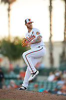 Baltimore Orioles relief pitcher Cody Carroll (49) delivers a pitch during a Grapefruit League Spring Training game against the Detroit Tigers on March 3, 2019 at Ed Smith Stadium in Sarasota, Florida.  Baltimore defeated Detroit 7-5.  (Mike Janes/Four Seam Images)