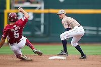 Virginia Cavaliers second baseman Ernie Clement (4) turns a double play against the Arkansas Razorbacks in Game 1 of the NCAA College World Series on June 13, 2015 at TD Ameritrade Park in Omaha, Nebraska. Virginia defeated Arkansas 5-3. (Andrew Woolley/Four Seam Images)