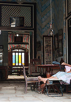 Person relaxing at an antique store in Galle, Sri Lanka