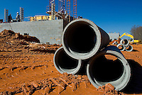 02/22/07:  Cement pipes lay ready to be placed during expansion/construction of a Charlotte-area shopping center. Charlotte, NC, is one of the country's fastest-growing cities. ..By Patrick Schneider- Patrick Schneider Photography.