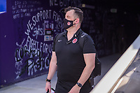 ORLANDO, FL - FEBRUARY 24: CANWNT Assistant walks out of the tunnel before a game between Brazil and Canada at Exploria Stadium on February 24, 2021 in Orlando, Florida.