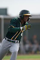 Oakland Athletics center fielder Dairon Blanco (30) hustles down the first base line during a Minor League Spring Training game against the Chicago Cubs at Sloan Park on March 13, 2018 in Mesa, Arizona. (Zachary Lucy/Four Seam Images)
