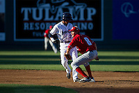 Ryan Metzler (8) of the Vancouver Canadians puts a tag on Erick Mejia (29) of the Everett Aquasox during a game at Everett Memorial Stadium in Everett, Washington on July 27, 2015.  Everett defeated Vancouver 6-0. (Ronnie Allen/Four Seam Images)