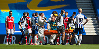 20th June 2020, American Express Stadium, Brighton, Sussex, England; Premier League football, Brighton versus Arsenal ;  Arsenals goalkeeper Bernd Leno points at Brighton and Hove Albions Neal Maupay as he is carried off on a stretcher with an injury caused by the contact