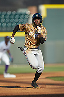Eric Jenkins (12) of the Down East Wood Ducks hustles towards third base against the Winston-Salem Dash at BB&T Ballpark on May 12, 2018 in Winston-Salem, North Carolina. The Wood Ducks defeated the Dash 7-5. (Brian Westerholt/Four Seam Images)