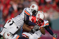 01 January 2007: Nebraska receiver Maurice Purify (#16) is tackled by Auburn defenders Eric Brock (#33) and Jerraud Powers (#8) during the 2007 AT&T Cotton Bowl Classic between The University of Auburn and The University of Nebraska at The Cotton Bowl in Dallas, TX.