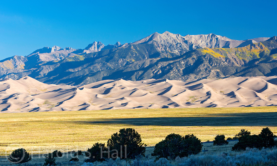 Sunrise at the Great Sand Dunes National Park Colorado seen from a distance.
