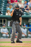 Home plate umpire Sam Vogt makes a strike call during the Midwest League game between the West Michigan Whitecaps and the Great Lakes Loons at the Dow Diamond on June 11, 2013 in Midland, Michigan.  The Loons defeated the Whitecaps 13-6.  (Brian Westerholt/Four Seam Images)
