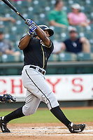 Omaha Storm Chasers outfielder Carlos Peguero (39) follows through on his home run swing during the Pacific Coast League baseball game against the Round Rock Express on June 1, 2014 at the Dell Diamond in Round Rock, Texas. The Express defeated the Storm Chasers 11-4. (Andrew Woolley/Four Seam Images)
