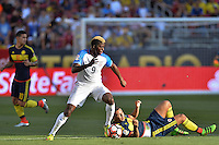 Santa Clara, CA - Friday June 03, 2016: United States forward Gyasi Zardes (9) gets past Colombia midfielder Edwin Cardona (8) during a Copa America Centenario Group A match between United States (USA) and Colombia (COL) at Levi's Stadium.
