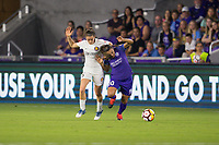 Orlando, FL - Saturday March 24, 2018: Utah Royals forward Kelley O'Hara (5) pressures Orlando Pride forward Marta Vieira da Silva (10) during a regular season National Women's Soccer League (NWSL) match between the Orlando Pride and the Utah Royals FC at Orlando City Stadium. The game ended in a 1-1 draw.