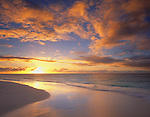 Anguilla, BWI<br /> Setting sun over the Caribbean waters with reflections on the beach of Lower Shoal Bay
