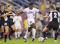 Charmaine Hooper of the Beat is double teamed by Margaret Tietjen and Kristy Whelchel of the Power. The Atlanta Beat and the NY Power played to a 1-1 tie on 7/26/03 at Mitchel Athletic Complex, Uniondale, NY..