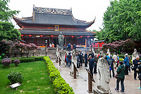 Nanjing, Jiangsu, China.  Statue of Confucius in front of Dacheng Hall.  Disciples of Confucius line the walkway on either side.
