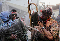 Pictured: A couple kiss after the flour wars in Galaxidi, Greece. Monday 19 February 2018<br /> Re: Clean Monday (Monday of Lent) celebration of flour wars (Alevromoutzouroma) in the town of Galaxidi, which coincides with the beginning of the Greek Orthodox Lent in Greece. The origins of the custom are unclear, however it appears in its current form since the mid-19th century.<br /> Locals and visitors of all ages gather to collect large quantities of flour which they throw to each other. Various types of coloring is added for effect while people paint their faces with charcoal.