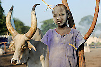 SOUTH SUDAN Bahr al Ghazal region , Lakes State, village Yeri cattle camp near Rumbek, Dinka boy Mathou, 11 years old, with Zebu cow / SUED-SUDAN  Bahr el Ghazal region , Lakes State, Dorf Yeri, Dinka mit Zebu Rindern im cattle camp bei Rumbek , Junge Mathou 11 Jahre